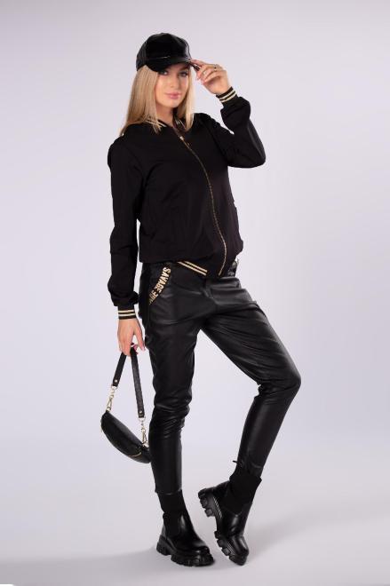 ELITE  woskowane spodnie o dopasowanym kroju M82229 Брюки Черный оптом